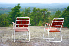 Two campchairs waiting on mountaintop Stock Photography