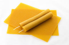 Two Candle  beeswax on honeycomb. Two Candle made of beeswax on honeycomb - background Royalty Free Stock Photography
