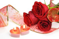 Two Candle Hearts and Roses. Two Valentine Burning Candle Hearts and Roses Royalty Free Stock Photography
