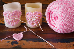 Two candle with  pink crochet handmade heart for Saint Valentine Royalty Free Stock Images