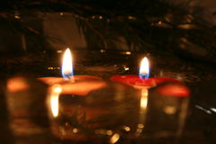 Two Candles 05. Two Light Reflected Candles Royalty Free Stock Photos