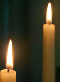 Two candles. Against a dark background Royalty Free Stock Image