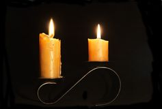 Two candles. Burning candles royalty free stock photography