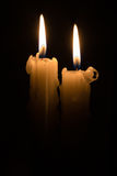 Two candles. In the dark Royalty Free Stock Image