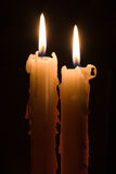 Two candles. In the dark Royalty Free Stock Photo