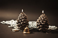Two candles as  with christmas-tree decorations Stock Photography