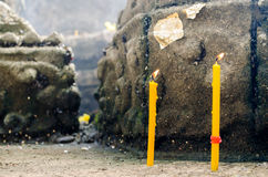 Two Candles behind The Buddha Statue Stock Photos