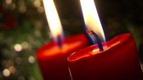Two Candles in blackness Stock Images