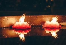 Candle reflections in a Chinese temple royalty free stock photo