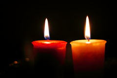 Two candles burning Stock Images
