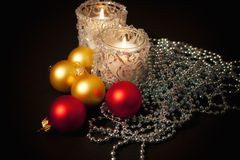 Two candles  with christmas-tree decoration Royalty Free Stock Photography
