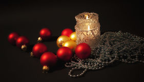 Two candles  with christmas-tree decoration Royalty Free Stock Images