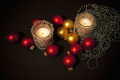 Two candles with christmas-tree decoration Stock Images