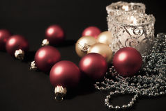 Two candles with christmas-tree decorations Stock Image