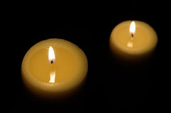 Two candles with dark background top view. Two candles lit with dark background top view Stock Photo