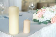 Two candles on the decorated table stock photography