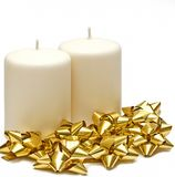 Two candles with gold bows Stock Photos