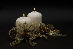Two candles and golden bonds. Stock Photo