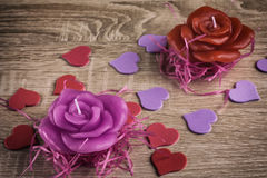 Two candles and hearts. Two candles in the form of roses and hearts for Valentine`s Day Stock Photo
