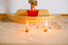 Two candles and lamp close-up. Interior Of Orthodox Church In Easter. baby christening. Ceremony in Christian . bathing. Candles and lamp close-up. Interior Of Royalty Free Stock Photos
