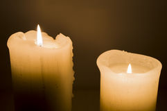 Two candles over purple velvet Royalty Free Stock Image