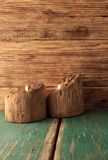 Two candles placed in very old wooden bars Royalty Free Stock Images