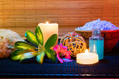 Two candles and and purple hibiscus flower, salt and soap. For massage royalty free stock images