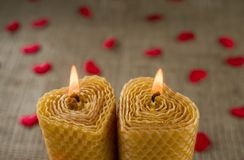 Two candles in the shape of a heart. Royalty Free Stock Photos