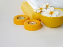 Two candles, three frangipani flowers and salt Royalty Free Stock Images