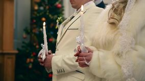 Two candles and veil - wedding ceremony in church. Ukraine stock footage
