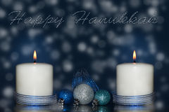 Two candles wih blue ribbon and decorations Royalty Free Stock Photography