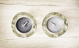 Two candlesticks of glass with tea lights Stock Images
