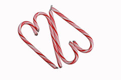 Two Candy Cane Hearts. Two red striped candy cane hearts shapes formed by four candy canes Royalty Free Stock Images