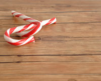 Two candy canes that is entwined Royalty Free Stock Images
