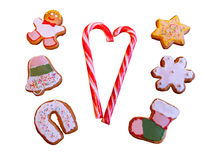 Two candy canes and homemade christmas cookies isolated on white. Background Stock Image