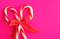 Two candy canes with a red bow Stock Photo
