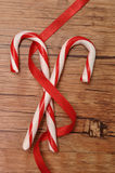 Two candy canes with a red ribbon Royalty Free Stock Image