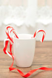 Two candy canes in a white mug Stock Images