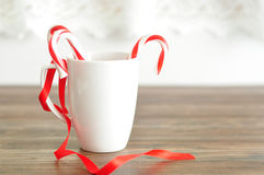 Two candy canes in a white mug Royalty Free Stock Image