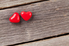 Two candy hearts over wood Royalty Free Stock Photo