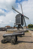 Two cannons and mill Royalty Free Stock Image