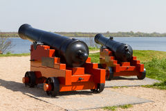 Two Cannons. Two old cannons aim at the sea Stock Image