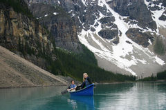 Two canoers. On Moraine Lake Stock Photography