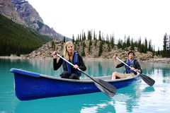 Two Canoers. On Moraine Lake Stock Photo
