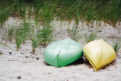 Two Canoes and Beach Grass on Gardiners Bay Stock Photography