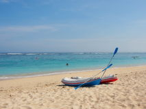 Two Canoes on the Beach Stock Images