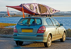 Two canoes fixed on top of a car. Royalty Free Stock Photos
