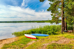 Two canoes on a lake bank. At summer day Stock Photography