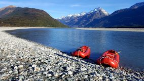 Two canoes parked by the side of a beautiful river royalty free stock image