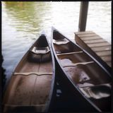 Two Canoes at a Pier in the Water Royalty Free Stock Photo